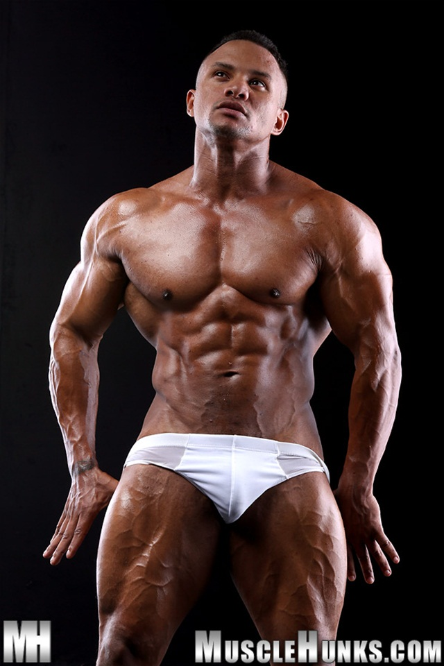 Black muscle stud Devon Ford shows off his rippling abs