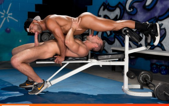 Horny muscle jocks Micah Brandt and Alex Mecum kiss on the floor of the gym as they rub their bulging shorts
